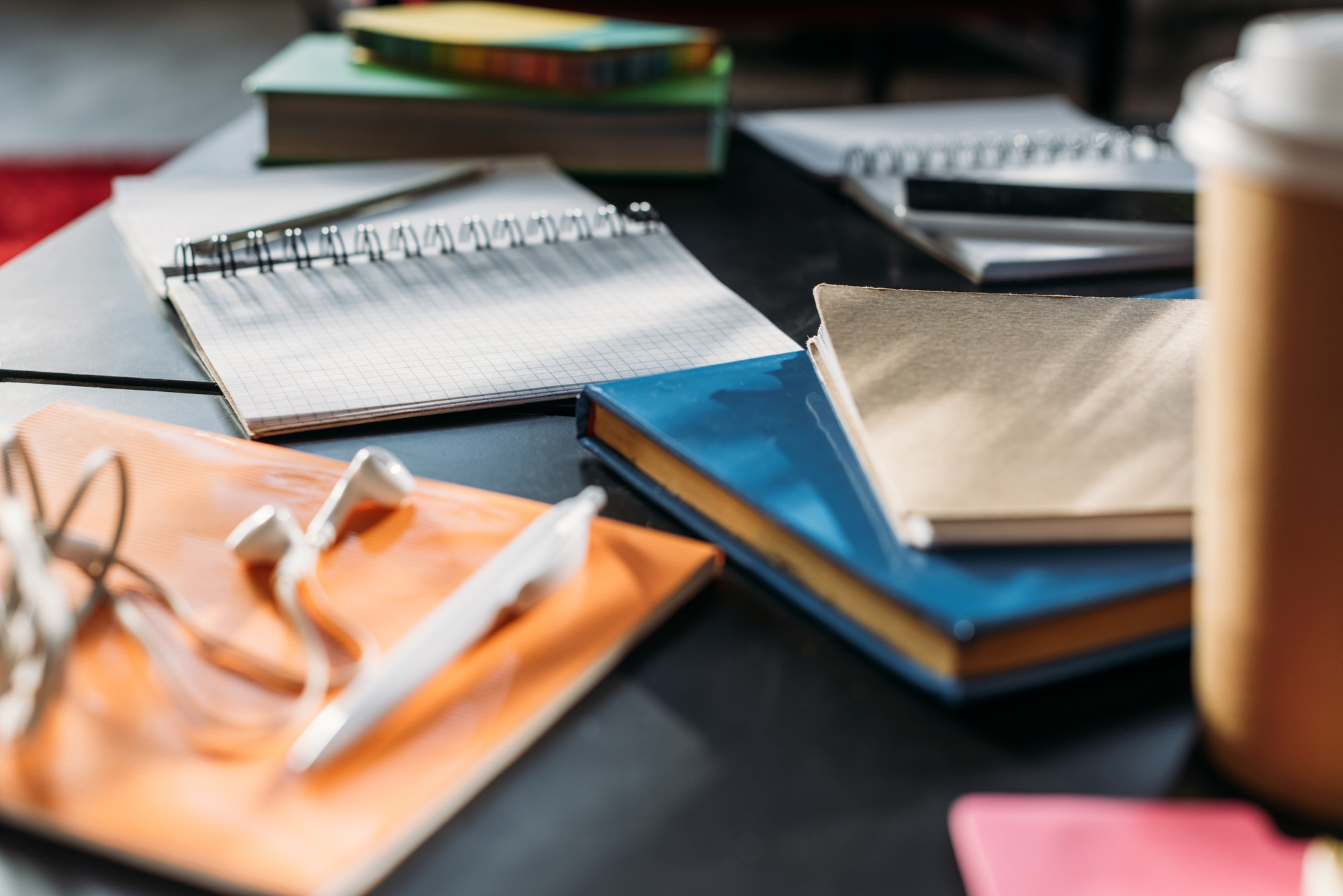 notebooks and books for studying on black table